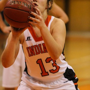 Larned Lady Indian Haley Skelton (#13) takes a free throw attempt during Seventh Annual Keady Basketball Classic First Round game between the Kinsley Lady Coyotes and the Larned Lady Indians with Kinsley winning 47 to 31 at Larned Middle School in Larned, Kansas on December 8, 2014. (Photo: Joey Bahr, www.joeybahr.com)