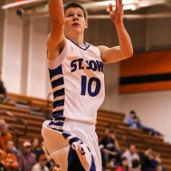 St. John Tiger Cole Kinnamon (#10) goes up for a layup during the Seventh Annual Keady Basketball Classic First Round game between the St. John Tigers and the Kiowa County Mavericks with St. John winning 74 to 30 at Larned Middle School in Larned, Kansas on December 9, 2014. (Photo: Joey Bahr, www.joeybahr.com)