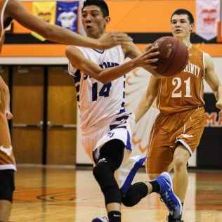St. John Tiger Alexis Valenzuela (#14) drives towards the basket during the Seventh Annual Keady Basketball Classic First Round game between the St. John Tigers and the Kiowa County Mavericks with St. John winning 74 to 30 at Larned Middle School in Larned, Kansas on December 9, 2014. (Photo: Joey Bahr, www.joeybahr.com)