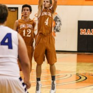 Kiowa County Maverick Landon Davis (#4) shoots a field goal during the Seventh Annual Keady Basketball Classic First Round game between the St. John Tigers and the Kiowa County Mavericks with St. John winning 74 to 30 at Larned Middle School in Larned, Kansas on December 9, 2014. (Photo: Joey Bahr, www.joeybahr.com)