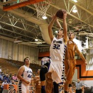 Kiowa County Maverick Landon Davis (#4) tries to knock the ball out of the hands of St. John Tiger Dean Wade (#32) during the Seventh Annual Keady Basketball Classic First Round game between the St. John Tigers and the Kiowa County Mavericks with St. John winning 74 to 30 at Larned Middle School in Larned, Kansas on December 9, 2014. (Photo: Joey Bahr, www.joeybahr.com)