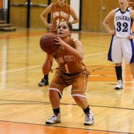 Kiowa County Lady Maverick Morgan Powell (#1) shoots a free throw attempt during the Seventh Annual Keady Basketball Classic First Round game between the St. John Lady Tigers and the Kiowa County Lady Mavericks with St. John winning 47 to 31 at Larned Middle School in Larned, Kansas on December 9, 2014. (Photo: Joey Bahr, www.joeybahr.com)