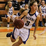 St. John Lady Tiger Torre Fisher (#3) drives to the basket during the Seventh Annual Keady Basketball Classic First Round game between the St. John Lady Tigers and the Kiowa County Lady Mavericks with St. John winning 47 to 31 at Larned Middle School in Larned, Kansas on December 9, 2014. (Photo: Joey Bahr, www.joeybahr.com)