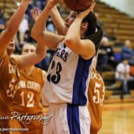 during the Seventh Annual Keady Basketball Classic First Round game between the St. John Lady Tigers and the Kiowa County Lady Mavericks with St. John winning 47 to 31 at Larned Middle School in Larned, Kansas on December 9, 2014. (Photo: Joey Bahr, www.joeybahr.com)