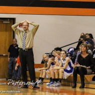 St. John Lady Tiger Head Coach Danny Smith reacts to a a call during the Seventh Annual Keady Basketball Classic First Round game between the St. John Lady Tigers and the Kiowa County Lady Mavericks with St. John winning 47 to 31 at Larned Middle School in Larned, Kansas on December 9, 2014. (Photo: Joey Bahr, www.joeybahr.com)