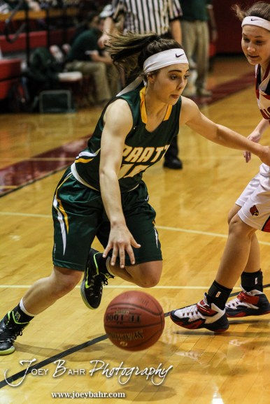 Pratt Lady Greenback Breann Becker (#10) drives towards the lane during the Pratt Lady Greenbacks at Hoisington Lady Cardinals Girls Basketball game with Pratt winning 34 to 23 at Hoisington Activity Center in Hoisington, Kansas on January 6, 2015. (Photo: Joey Bahr, www.joeybahr.com)