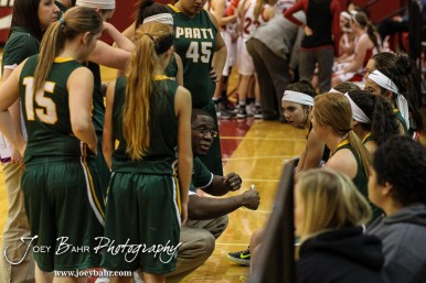 Pratt Lady Greenback Head Coach Emmanuel Adigun talks to his players during a time out in the Pratt Lady Greenbacks at Hoisington Lady Cardinals Girls Basketball game with Pratt winning 34 to 23 at Hoisington Activity Center in Hoisington, Kansas on January 6, 2015. (Photo: Joey Bahr, www.joeybahr.com)