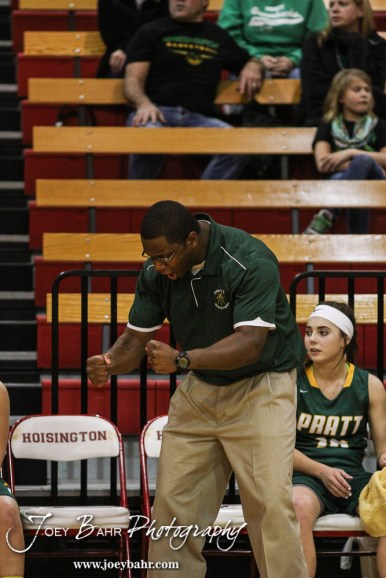 Pratt Lady Greenback Head Coach Emmanuel Adigun celebrates a basket being scored during the Pratt Lady Greenbacks at Hoisington Lady Cardinals Girls Basketball game with Pratt winning 34 to 23 at Hoisington Activity Center in Hoisington, Kansas on January 6, 2015. (Photo: Joey Bahr, www.joeybahr.com)
