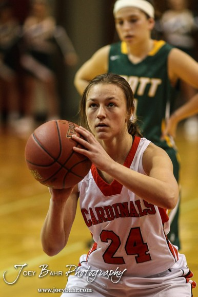 Hoisington Lady Cardinal Lexi Sanders (#24) shoots a free throw during the Pratt Lady Greenbacks at Hoisington Lady Cardinals Girls Basketball game with Pratt winning 34 to 23 at Hoisington Activity Center in Hoisington, Kansas on January 6, 2015. (Photo: Joey Bahr, www.joeybahr.com)
