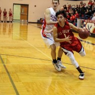 Ell-Saline Cardinal Luiz Antonio Arceo (#1) drives to the basket during the 2A Sub-State First Round Game with the Ellinwood Eagles vs the Ell-Saline Cardinals with Ellinwood winning 59 to 37 at Ellinwood High School in Ellinwood, Kansas on March 2, 2015. (Photo: Joey Bahr, www.joeybahr.com)