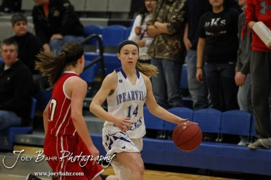 Spearville Lady Lancer Tausha Craft (#14) looks for a teammate to pass to during the 2A Sub-State First Round Game with the Spearville Lady Lancers vs the Kinsley Lady Coyotes with Spearville winning 66 to 53 at Spearville High School in Spearville, Kansas on March 3, 2015. (Photo: Joey Bahr, www.joeybahr.com)