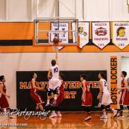 during the 2015 Keady Basketball Classic First Round game between the St. John Tigers and the Kinsley Coyotes with St. John winning 80 to 38