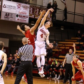 Hoisington Cardinal Cameron Davis (#5) and Minneapolis Lion Gavin Rothenberger (#4) jump for the opening tip off during the 2016 Hoisington Winter Jam Boys Championship Basketball game between the Hoisington Cardinals and the Minneapolis Lions with Hoisington winning 39 to 38 of Hoisington Activity Center in Hoisington, Kansas on January 23, 2016. (Photo: Joey Bahr, www.joeybahr.com)