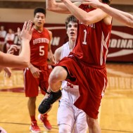 Hoisington Cardinal Brenner Donovan (#1) drives the lay for a layup during the 2016 Hoisington Winter Jam Boys Championship Basketball game between the Hoisington Cardinals and the Minneapolis Lions with Hoisington winning 39 to 38 of Hoisington Activity Center in Hoisington, Kansas on January 23, 2016. (Photo: Joey Bahr, www.joeybahr.com)