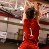 Hoisington Cardinal Brenner Donovan (#1) dunks the ball during the 2016 Hoisington Winter Jam Boys Championship Basketball game between the Hoisington Cardinals and the Minneapolis Lions with Hoisington winning 39 to 38 of Hoisington Activity Center in Hoisington, Kansas on January 23, 2016. (Photo: Joey Bahr, www.joeybahr.com)