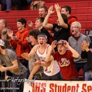 The Hoisington Cardinal Student Section celebrate he dunk by Brenner Donovan (#1) during the 2016 Hoisington Winter Jam Boys Championship Basketball game between the Hoisington Cardinals and the Minneapolis Lions with Hoisington winning 39 to 38 of Hoisington Activity Center in Hoisington, Kansas on January 23, 2016. (Photo: Joey Bahr, www.joeybahr.com)