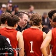 Hoisington Cardinal Head Coach Kyle Haxton draws up a play for his team during the 2016 Hoisington Winter Jam Boys Championship Basketball game between the Hoisington Cardinals and the Minneapolis Lions with Hoisington winning 39 to 38 of Hoisington Activity Center in Hoisington, Kansas on January 23, 2016. (Photo: Joey Bahr, www.joeybahr.com)