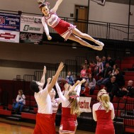 The Hoisington Cardinal Cheerleaders perform a stunt during time out at the 2016 Hoisington Winter Jam Boys Championship Basketball game between the Hoisington Cardinals and the Minneapolis Lions with Hoisington winning 39 to 38 of Hoisington Activity Center in Hoisington, Kansas on January 23, 2016. (Photo: Joey Bahr, www.joeybahr.com)