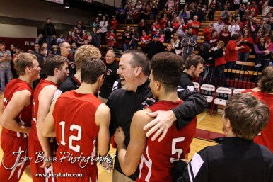 Hoisington Cardinal Head Coach Kyle Haxton celebrates winning the Championship with his players after the 2016 Hoisington Winter Jam Boys Championship Basketball game between the Hoisington Cardinals and the Minneapolis Lions with Hoisington winning 39 to 38 of Hoisington Activity Center in Hoisington, Kansas on January 23, 2016. (Photo: Joey Bahr, www.joeybahr.com)