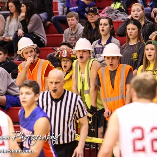 Hoisington students try to disrupt a play during the 2016 Hoisington Winter Jam Boys Semi-Final Basketball game between the Hoisington Cardinals and the Ellinwood Eagles with Hoisington winning 42 to 39 of Hoisington Activity Center in Hoisington, Kansas on January 22, 2016. (Photo: Joey Bahr, www.joeybahr.com)
