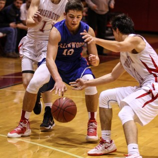 Ellinwood Eagle Tyson Martinez (#10) tries to control a ball as Hoisington Cardinals Brenner Donovan (#1) and Corbin Crawford (#13) surround him during the 2016 Hoisington Winter Jam Boys Semi-Final Basketball game between the Hoisington Cardinals and the Ellinwood Eagles with Hoisington winning 42 to 39 of Hoisington Activity Center in Hoisington, Kansas on January 22, 2016. (Photo: Joey Bahr, www.joeybahr.com)