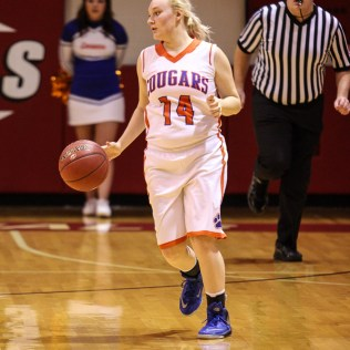 Otis-Bison Lady Cougar Caitlin Schilowsky (#14) brings the ball down the court during the 2016 Hoisington Winter Jam Girls Fifth Place Basketball game between the Otis-Bison Lady Cougars and the Ellsworth Lady Bearcats with Otis-Bison winning 46 to 40 of Hoisington Activity Center in Hoisington, Kansas on January 23, 2016. (Photo: Joey Bahr, www.joeybahr.com)