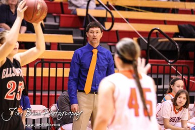 Otis-Bison Lady Cougar Head Coach Robert Trapp watches a play develop during the 2016 Hoisington Winter Jam Girls Fifth Place Basketball game between the Otis-Bison Lady Cougars and the Ellsworth Lady Bearcats with Otis-Bison winning 46 to 40 of Hoisington Activity Center in Hoisington, Kansas on January 23, 2016. (Photo: Joey Bahr, www.joeybahr.com)