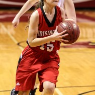 Hoisington Lady Cardinal Emma Harmon (#15) drives to the basket during the 2016 Hoisington Winter Jam Girls Semi-Final Basketball game between the LaCrosse Lady Leopards and the Hoisington Lady Cardinals with LaCrosse winning 42 to 39 of Hoisington Activity Center in Hoisington, Kansas on January 22, 2016. (Photo: Joey Bahr, www.joeybahr.com)