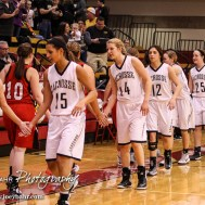 Members of the LaCrosse Lady Leopards and Hoisington Lady Cardinals shake hands following the 2016 Hoisington Winter Jam Girls Semi-Final Basketball game between the LaCrosse Lady Leopards and the Hoisington Lady Cardinals with LaCrosse winning 42 to 39 of Hoisington Activity Center in Hoisington, Kansas on January 22, 2016. (Photo: Joey Bahr, www.joeybahr.com)