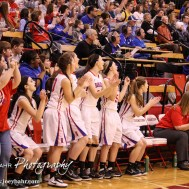 The Russell Lady Bronco bench celebrates a made basket during the 2016 Hoisington Winter Jam Girls Championship Basketball game between the LaCrosse Lady Leopards and the Russell Lady Broncos with LaCrosse winning 54 to 48 of Hoisington Activity Center in Hoisington, Kansas on January 23, 2016. (Photo: Joey Bahr, www.joeybahr.com)