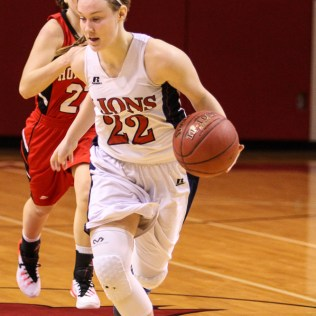 Minneapolis Lady Lion Lindsay Shupe (#22) drives the ball down the court during the 2016 Hoisington Winter Jam Girls Thrid Place Basketball game between the Hoisington Lady Cardinals and the Minneapolis Lady Lions with Hoisington winning 48 to 43 of Hoisington Activity Center in Hoisington, Kansas on January 23, 2016. (Photo: Joey Bahr, www.joeybahr.com)