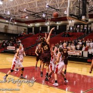 Victoria Lady Knight Kali Weber (#15) takes a shot from outside the lane during the 2016 Hoisington Winter Jam First Round Girls Basketball game between the Hoisington Lady Cardinals and the Victoria Lady Knights with Hoisington winning 44 to 34 of Hoisington Activity Center in Hoisington, Kansas on January 19, 2016. (Photo: Joey Bahr, www.joeybahr.com)