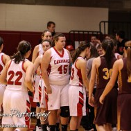 Members of the Victoria Lady Knights and Hoisington Lady Cardinals shake hands following the 2016 Hoisington Winter Jam First Round Girls Basketball game between the Hoisington Lady Cardinals and the Victoria Lady Knights with Hoisington winning 44 to 34 of Hoisington Activity Center in Hoisington, Kansas on January 19, 2016. (Photo: Joey Bahr, www.joeybahr.com)