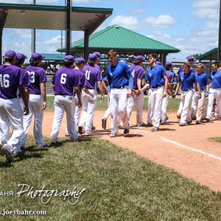 Members of the St. Mary's Colgan Panthers and Medicine Lodge Indians shake hands after the completion of the game. The St. Mary's Colgan Panthers win the KSHSAA Class 2-1A State Baseball Championship over the Medicine Lodge Indians by a score of 13 to 3 at the Great Bend Sports Complex in Great Bend, Kansas on May 28, 2016. (Photo: Joey Bahr, www.joeybahr.com)