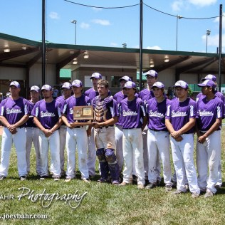 The Medicine Lodge Indians take a team photo with the KSHSAA Class 2-1A State Runner-up Trophy. The St. Mary's Colgan Panthers win the KSHSAA Class 2-1A State Baseball Championship over the Medicine Lodge Indians by a score of 13 to 3 at the Great Bend Sports Complex in Great Bend, Kansas on May 28, 2016. (Photo: Joey Bahr, www.joeybahr.com)