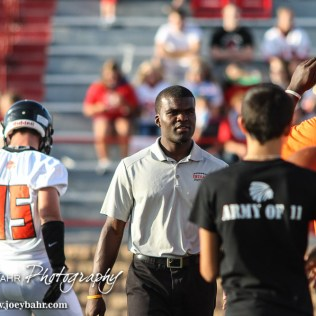 Larned Indian Head Coach A. B. Stokes talks to his players during warmups for the Hoisington Cardinal versus Larned Indian Football game with Hoisington winning 53 to 21 at Elton Brown Field in Hoisington, Kansas on September 4, 2015. (Photo: Joey Bahr, www.joeybahr.com)