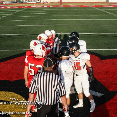 Team Captains shake hands before the Hoisington Cardinal versus Larned Indian Football game with Hoisington winning 53 to 21 at Elton Brown Field in Hoisington, Kansas on September 4, 2015. (Photo: Joey Bahr, www.joeybahr.com)
