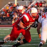Hoisington Cardinal Landen Urban (#51) blocks for the backfield during the Hoisington Cardinal versus Larned Indian Football game with Hoisington winning 53 to 21 at Elton Brown Field in Hoisington, Kansas on September 4, 2015. (Photo: Joey Bahr, www.joeybahr.com)