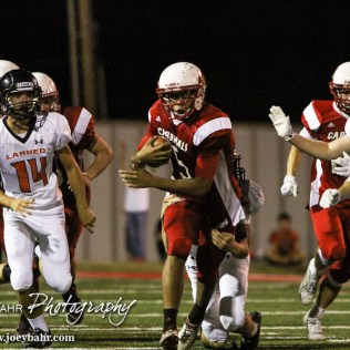 Hoisington Cardinal Cameron Davis (#5) returns a kickoff during the Hoisington Cardinal versus Larned Indian Football game with Hoisington winning 53 to 21 at Elton Brown Field in Hoisington, Kansas on September 4, 2015. (Photo: Joey Bahr, www.joeybahr.com)