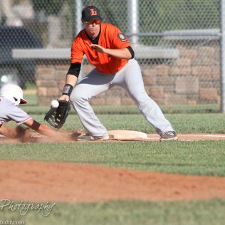 Larned Indian Johnathan Herter (#2) prepares to field a ball as Great Bend Chief Kody Lang (#13) dives to get back to First Base. The Great Bend Chiefs win game 1 of a American Legion baseball double header over the Larned Indians 7 to 6 after 8 innings at the Great Bend Sports Complex in Great Bend, Kansas on June 29, 2016. (Photo: Joey Bahr, www.joeybahr.com)