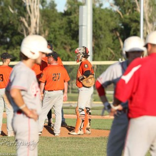 Larned Indian Manager Chad Erway (#27) talks to his players as the Great Bend Chiefs threaten to cut into the four run lead. The Great Bend Chiefs win game 1 of a American Legion baseball double header over the Larned Indians 7 to 6 after 8 innings at the Great Bend Sports Complex in Great Bend, Kansas on June 29, 2016. (Photo: Joey Bahr, www.joeybahr.com)