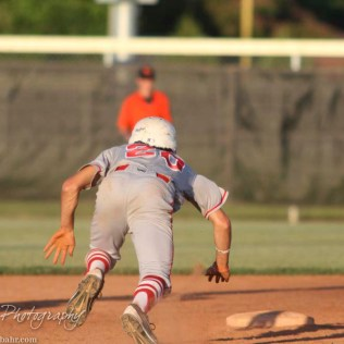 Great Bend Chief Bryce Lytle (#20) dives back to Second Base after taking a lead off. The Great Bend Chiefs win game 1 of a American Legion baseball double header over the Larned Indians 7 to 6 after 8 innings at the Great Bend Sports Complex in Great Bend, Kansas on June 29, 2016. (Photo: Joey Bahr, www.joeybahr.com)