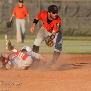 Larned Indian Landon Erway (#10) covers Second Base as Great Bend Chief Bryce Lytle (#20) slides in safe. The Great Bend Chiefs win game 1 of a American Legion baseball double header over the Larned Indians 7 to 6 after 8 innings at the Great Bend Sports Complex in Great Bend, Kansas on June 29, 2016. (Photo: Joey Bahr, www.joeybahr.com)