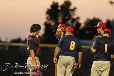 Doniphan County Head Coach Jeffrey Watts talks to his pitcher after a rough start in the top of the First Inning. The Great Bend Braves won their first round game over Doniphan County 14 to 4 in the American Legional Class A Baseball State Tournament at the Great Bend Sports Complex in Great Bend, Kansas on July 20, 2016. (Photo: Joey Bahr, www.joeybahr.com)