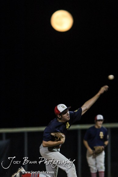 The full moon rises in the background as Doniphan County #5 Bryson Kirkland delivers a pitch. The Great Bend Braves won their first round game over Doniphan County 14 to 4 in the American Legional Class A Baseball State Tournament at the Great Bend Sports Complex in Great Bend, Kansas on July 20, 2016. (Photo: Joey Bahr, www.joeybahr.com)