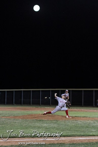 Great Bend Braves #5 Brayden Powell throws a pitch as the full moon gets higher in the sky. The Great Bend Braves won their first round game over Doniphan County 14 to 4 in the American Legional Class A Baseball State Tournament at the Great Bend Sports Complex in Great Bend, Kansas on July 20, 2016. (Photo: Joey Bahr, www.joeybahr.com)