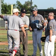 An umpire stands between Great Bend Chief Head Coach Roger Ward and Garden City Elite Head Coach Lyle Befort as they discuss each other's teams. The Great Bend Chiefs won the AAA Lower Zone 1 & 2 Tournament by defeating the Garden City Elite 10 to 4 at Great Bend Sports Complex in Great Bend, Kansas on July 18, 2016. (Photo: Joey Bahr, www.joeybahr.com)