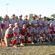 The Great Bend Chiefs line up for a team photo with the Zone Tournament Trophy. The Great Bend Chiefs won the AAA Lower Zone 1 & 2 Tournament by defeating the Garden City Elite 10 to 4 at Great Bend Sports Complex in Great Bend, Kansas on July 18, 2016. (Photo: Joey Bahr, www.joeybahr.com)