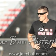 Great Bend Panther Head Coach Erin Beck watches his players warm up for the game. The Great Bend Panthers defeated the Dodge City Demons 34 to 27 at Memorial Stadium in Great Bend, Kansas on September 23, 2016. (Photo: Joey Bahr, www.joeybahr.com)
