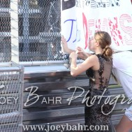 Two Great Bend students hang a sign on the fence before the game. The Great Bend Panthers defeated the Dodge City Demons 34 to 27 at Memorial Stadium in Great Bend, Kansas on September 23, 2016. (Photo: Joey Bahr, www.joeybahr.com)